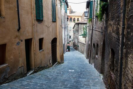 narrow street: Narrow Alley With Old Buildings In Medieval Town of Siena, Tuscany, Italy