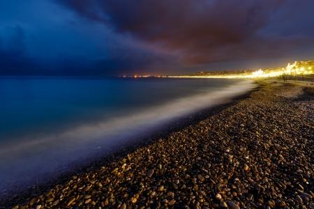 cote d'azure: Romantic Cote dAzure Beach at Night, Nice, French Riviera, France Stock Photo