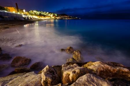 cote: Romantic Cote dAzure Beach at Night, Nice, French Riviera, France Stock Photo