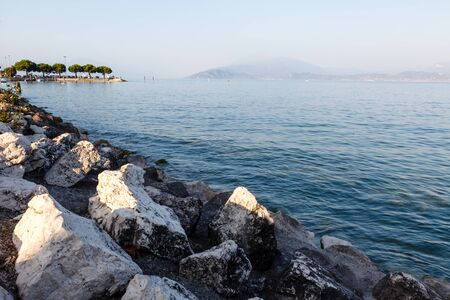 Lake Garda near Town of Sirmione in the Evening, Lombardy, Italy photo