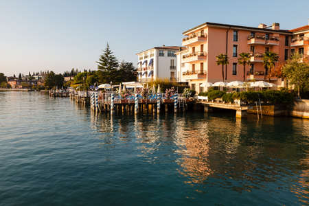 garda: Romantic Cafe on the Garda Lake Shore in Sirmione, Italy Stock Photo