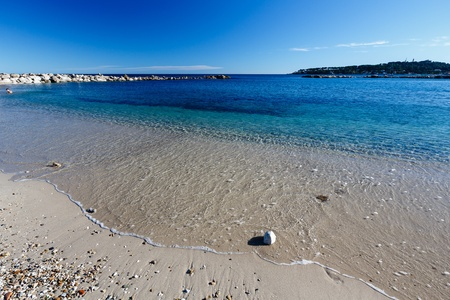 riviera: Sunny Beach and Breakwater in Antibes on French Riviera, France