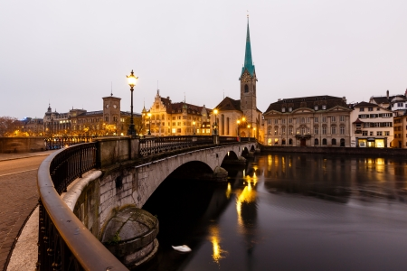View of Zurich and Old City Center Reflecting in the river Limmat at Morning, Switzerland Фото со стока