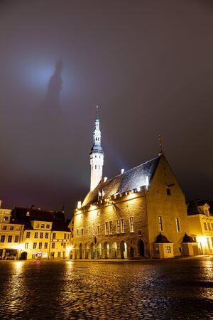 tallin: Tallinn Town Hall Casting Shadow on the Dark Sky, Estonia