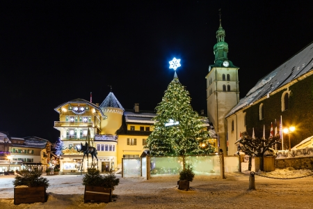 central square: Illuminated Central Square of Megeve on Christmas Eve, French Alps, France Stock Photo