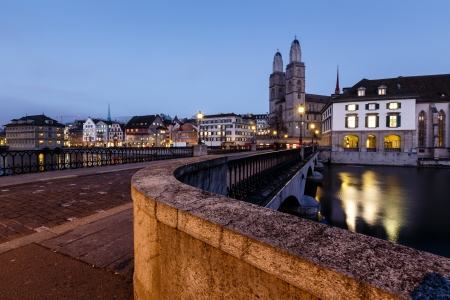 View on Grossmunster Church and Munsterbrucke Bridge in the Evening, Zurich, Switzerland photo