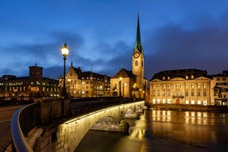 zurich: Illuminated Fraumunster Church and River Limmat in Zurich, Switzerland