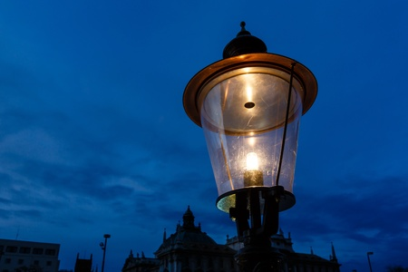 Vintage Illuminated Street Lamp in the Center of Munich, Germany Stock Photo - 17418652