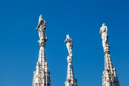Three Sculptures on the Roof of Milan Cathedral, Lombardy, Italy photo