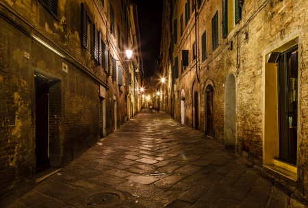 siena italy: Narrow Alley With Old Buildings In Medieval Town of Siena, Tuscany, Italy
