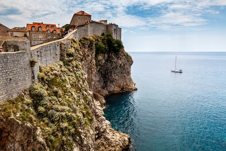 impregnable: Yacht and Impregnable Walls of Dubrovnik, Croatia Stock Photo