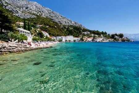 adriatic: Beautiful Beach and Transparent Turquoise Adriatic Sea near Split, Croatia Stock Photo