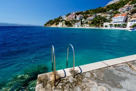 Metal Ladder on the Beach and Azure Mediterranean Sea near Split, Croatia