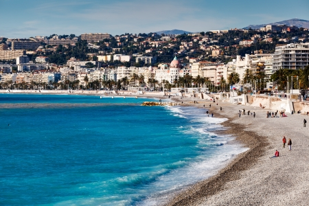 Promenade des Anglais and Beautiful Beach in Nice, French Riviera, France Фото со стока