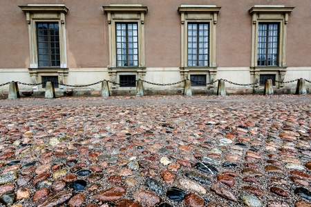 king palace: Wet Cobblestone and King Palace Facade in Gamla Stan  Old Town  of Stockholm, Sweden