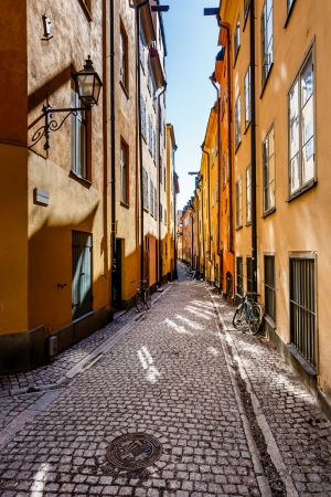 Narrow Street in Old Town (Gamla Stan) of Stockholm, Sweden Фото со стока