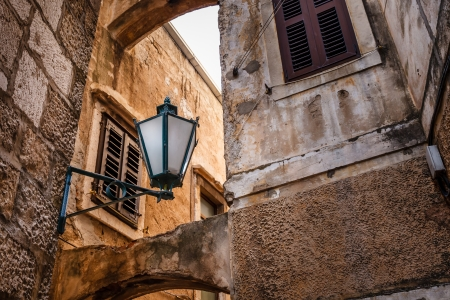 Street Lamp in the Narrow Street of Omis, Croatia photo