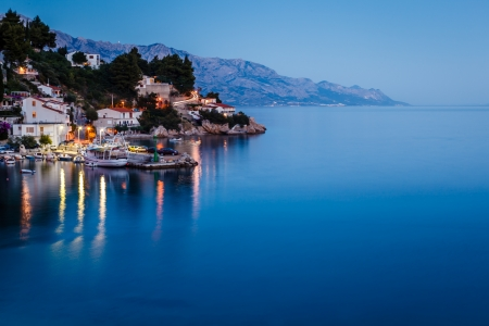 Peaceful Croatian Village and Adriatic Bay Illuminated by Moon, Croatia Фото со стока