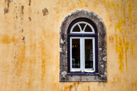 Arched Window on Yellow Wall of Pena Palace, Sintra, Portugal photo