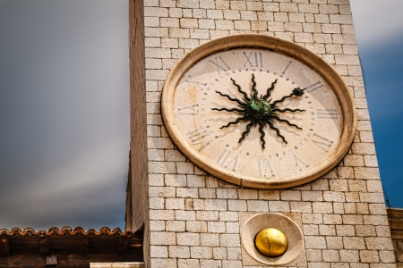 bell shaped: Sun Shaped Clock on Bell Tower in Dubrovnik, Croatia