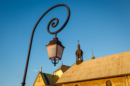 street lamps: Street Lamp and Medieval Church in Megeve, French Alps