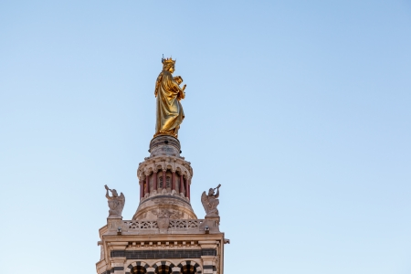 garde: Golden Statue of the Madonna Holding the little Jesus on the top of Notre-Dame de la Garde in Marseilles, France