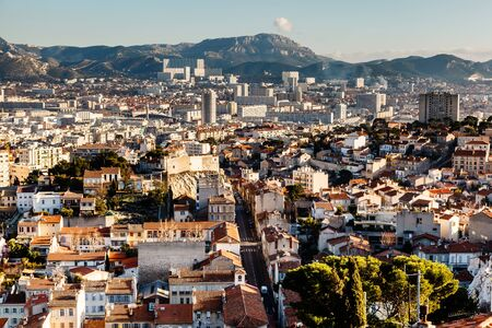 marcelle: Aerial View of Marseille City and Mountains in Background, France