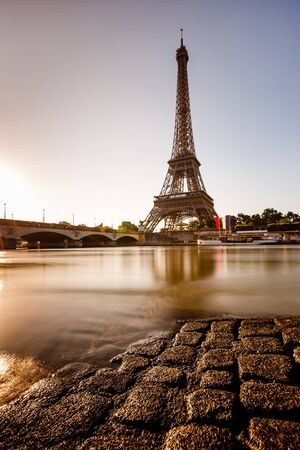 eifel: Eiffel Tower and Cobbled Embankment of Seine River at Sunrise, Paris, France