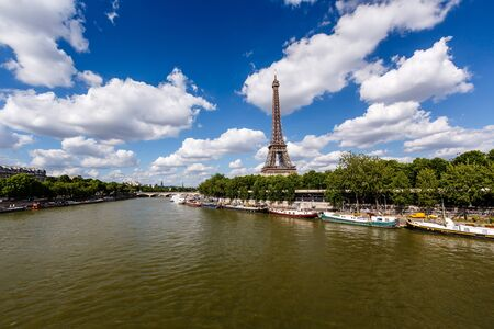 eifel: Eiffel Tower and Seine River with White Clouds in Background, Paris, France