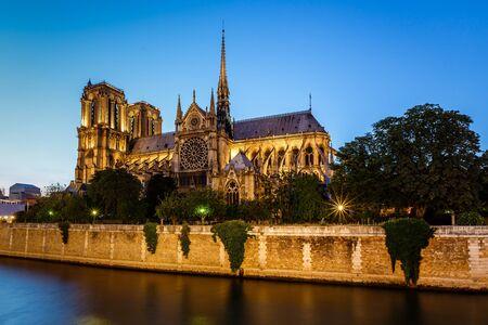Notre Dame de Paris Cathedral and Seine River in the Evening, Paris, France photo