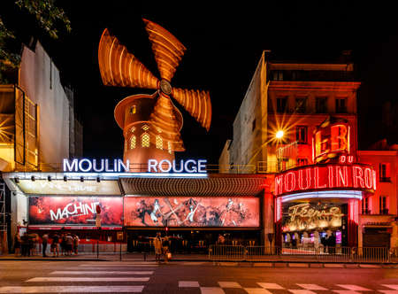 locating: PARIS - JULY 1  The Moulin Rouge by night, on July 1, 2013 in Paris, France  Moulin Rouge is a famous cabaret built in 1889, locating in the Paris red-light district of Pigalle Editorial