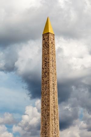 obelisk stone: Egyptian Obelisk of Luxor Standing at the Center of the Place de la Concorde in Paris, France