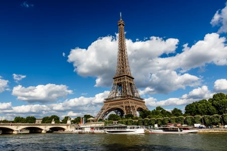 Eiffel Tower and Seine River with White Clouds in Background, Paris, France photo
