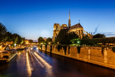 Notre Dame de Paris Cathedral and Boat Lights Trails on Seine River, Paris, France photo