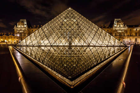 PARIS - JULY 1  Glass Pyramid in Front of the Louvre Museum on July 1, 2013  The Louvre is one of the world
