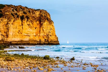 White Yacht at Porto de Mos Beach in Lagos, Algarve, Portugal Stock Photo