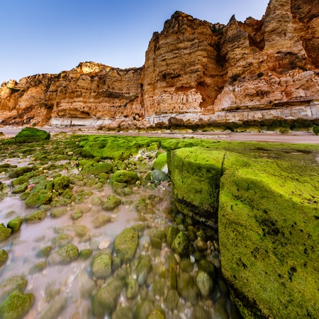 Rocks and Cliffs of Porto de Mos Beach in the Morning, Lagos, Algarve, Portugal photo