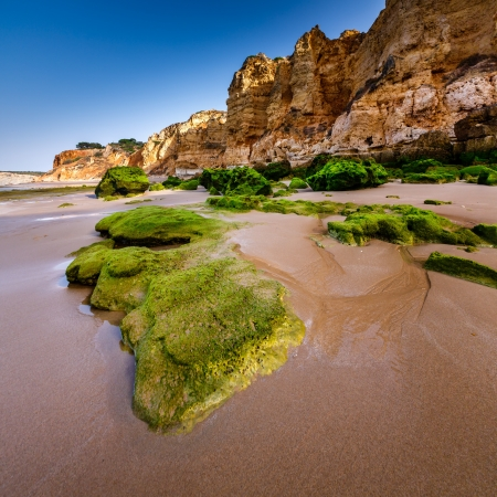 coastal erosion: Rocks and Cliffs of Porto de Mos Beach in the Morning, Lagos, Algarve, Portugal Stock Photo