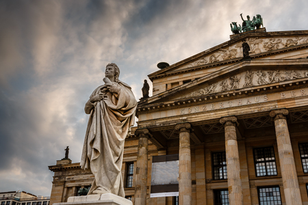 Friedrich Schiller Sculpture and Concert Hall on Gendarmenmarkt Square in Berlin, Germany photo