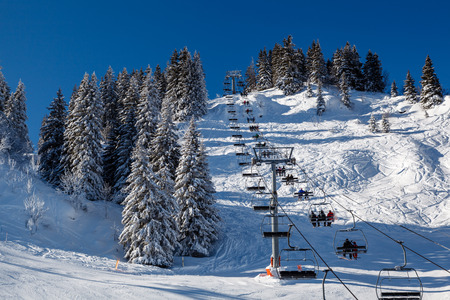 Sunny Ski Slope and Ski Lift near Megeve in French Alps, France photo