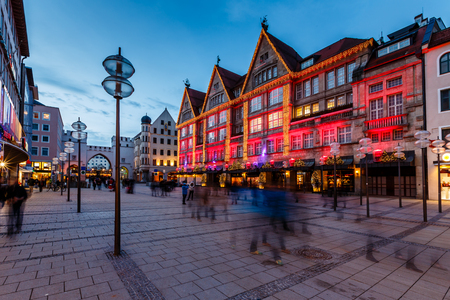 Illuminated Neuhauser Street and Karlsplatz Gate in Munich at the Evening, Germany Фото со стока