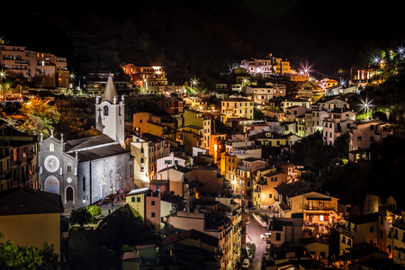 Aerial View on Illuminated Church and Riomaggiore at Night, Cinque Terre, Italy photo