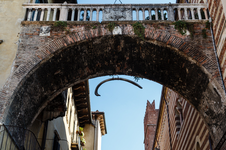 Arch Between Piazza Erbe and Signori in Verona with Hanging Whale Bone, Veneto, Italy photo
