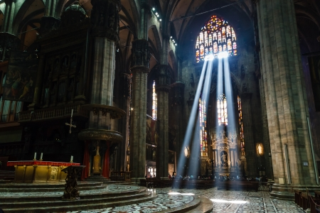 gothic church: The Bright Beam of Light Inside Milan Cathedral, Italy