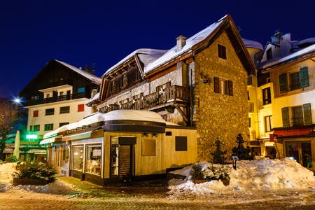 Illuminated Street of Megeve on Christmas Night, French Alps, France photo