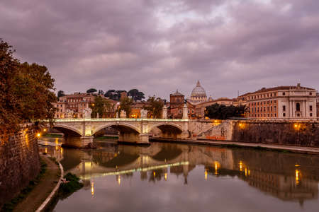 Illuminated Tiber River Embankment and Saint Peter photo
