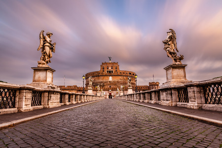 Castle of Holy Angel and Holy Angel Bridge over the Tiber River in Rome at Dawn, Italy photo