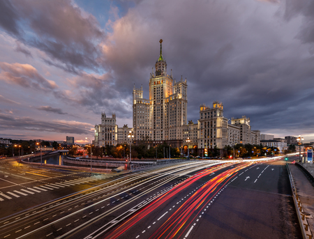 Skyscraper on Kotelnicheskaya Embankment and Traffic Trails at Dusk, Moscow, Russia photo