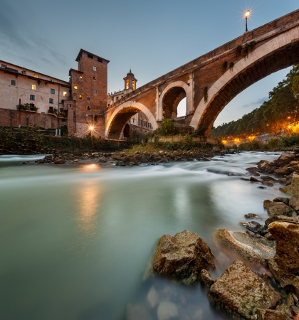 tiber: Fabricius Bridge and Tiber Island at Twilight, Rome, Italy  This is the oldest Roman bridge in Rome, still existing in its original state from 62 BC, built by Lucius Fabricius