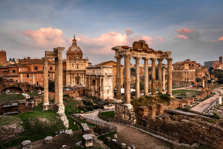 Roman Forum  Foro Romano  and Ruins of Septimius Severus Arch and Saturn Temple at Sunset, Rome, Italy photo